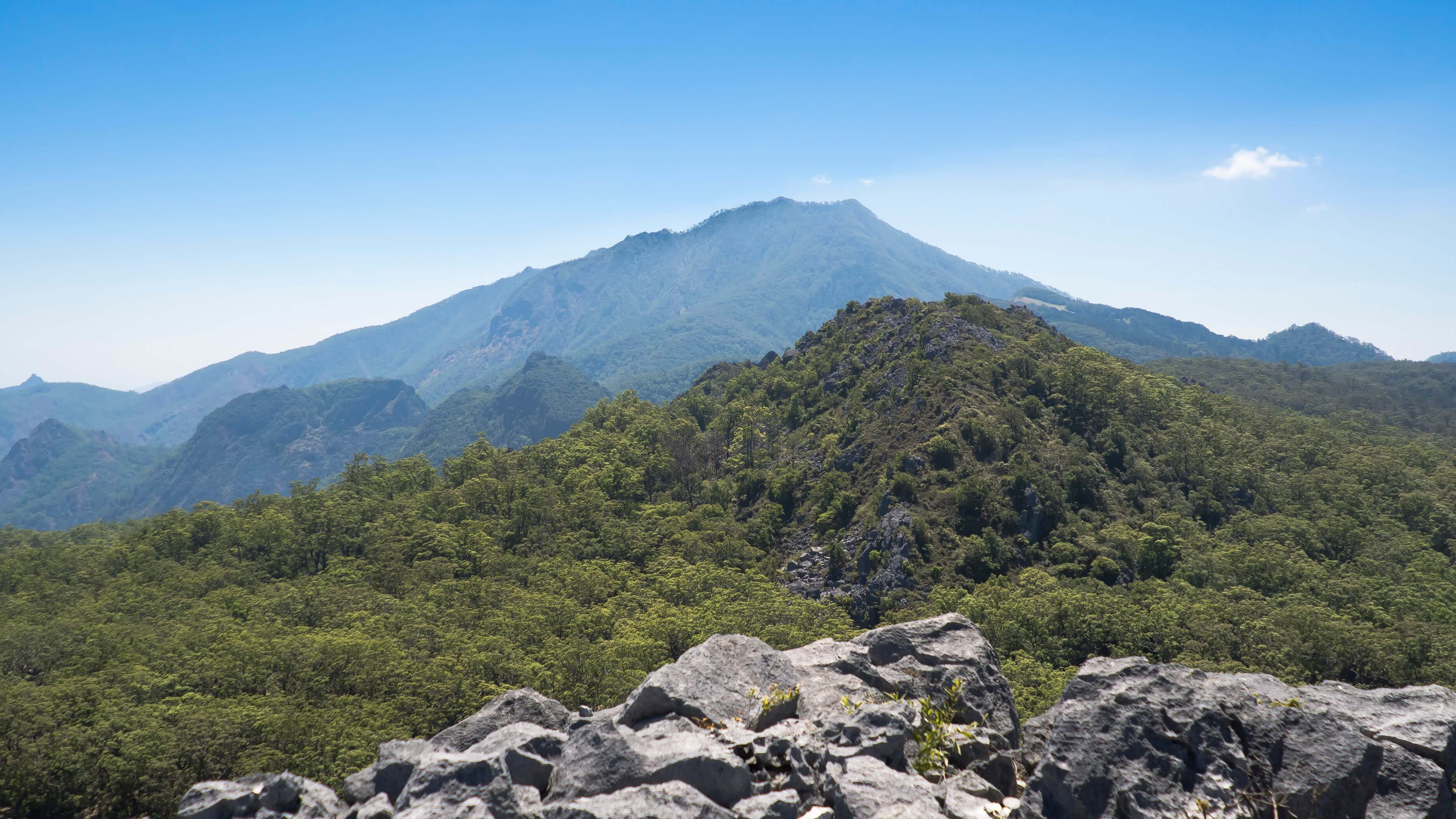 View of Mount Mutis from Benteng Oenino, a rock hill that was believed to serve as a fortress in ancient Timorese wars. Orang Mollo inhabit the foothills of Mount Mutis, the source of four major Timorese rivers.