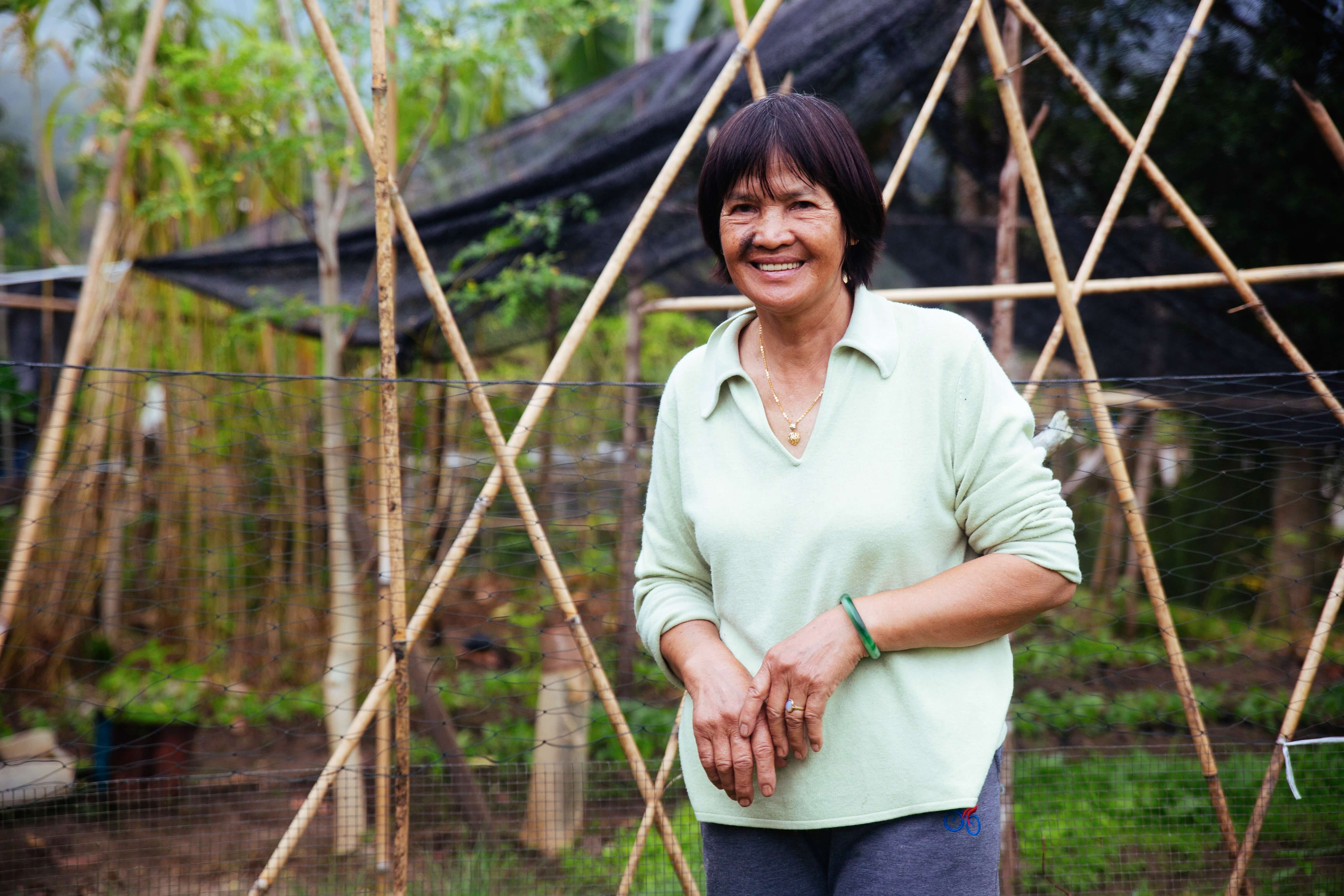 Aunty Ribed stands in front of her vegetable patch at her home in Long Semadoh, Sarawak.